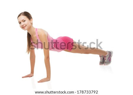 Young sporty woman doing exercises over white background