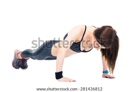 Young sporty woman doing push ups isolated on a white background - stock photo
