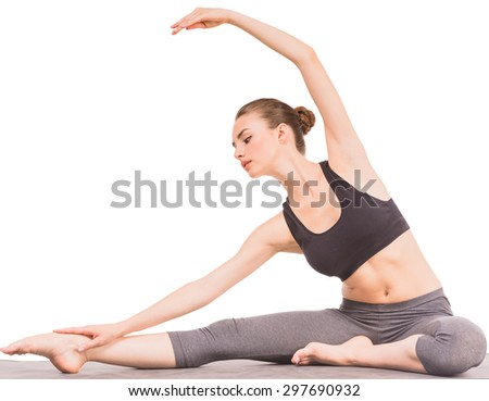 Young sporty woman doing stretching exercises in studio. - stock photo