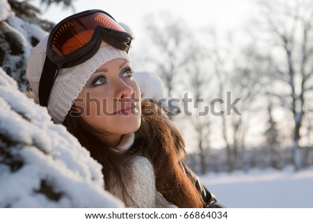 Young sporty woman in ski glasses. Outdoors. - stock photo