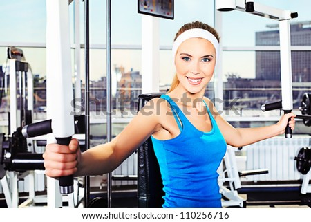 Young sporty woman in the gym centre.