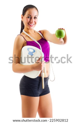 Young sporty woman with apple and scales isolated - stock photo