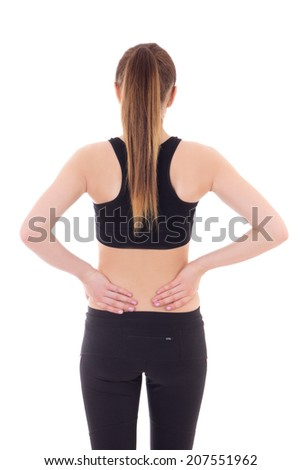 young sporty woman with pain in her back isolated on white background - stock photo