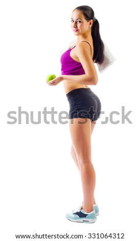 Young sporty woman with towel and apple isolated - stock photo