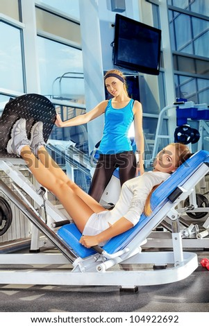 Young sporty women doing exercises in the gym centre. - stock photo