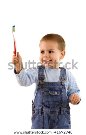 Young standing his toothbrush, isolated in white background - stock photo