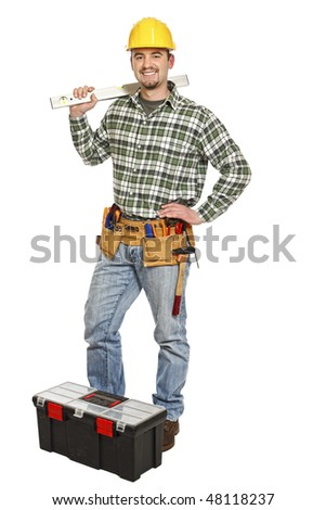 young standing manual worker and tools isolated on white - stock photo