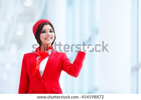 Young stewardess at airport