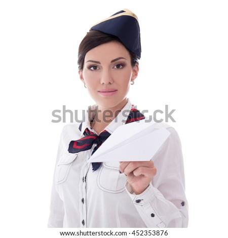 young stewardess holding paper plane isolated on white background - stock photo