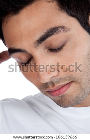 Young stressed man with eye closed isolated on white background. - stock photo