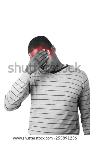 Young Stressed man with hand on his forehead showing sadness and despair - stock photo