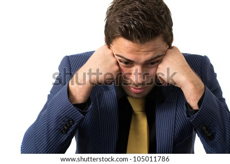 Young stressed overwhelmed businessman wearing a suit and golden tie