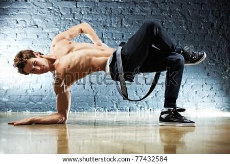 Young strong man break dance. - stock photo