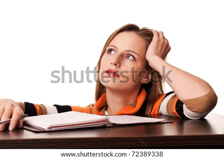 Young student girl dreaming on lesson on white background