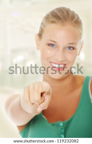 Young student girl pointing at you. - stock photo
