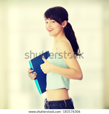 Young student girl with thumb up - stock photo