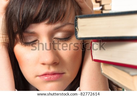 Young student has a lot to study this semester - stock photo