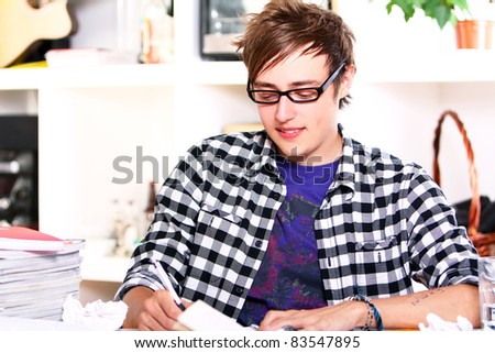 Young  student in glasses at home - stock photo