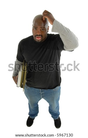 Young student scratching his head in confusion; isolated on white - stock photo