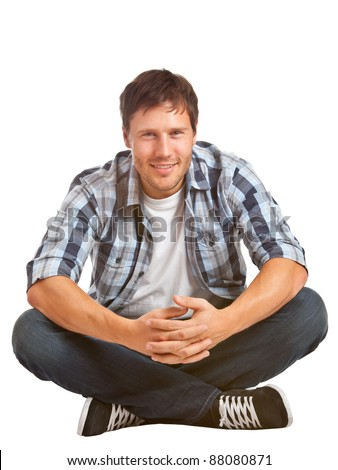 Young student sitting on the floor - isolated on white background - stock photo