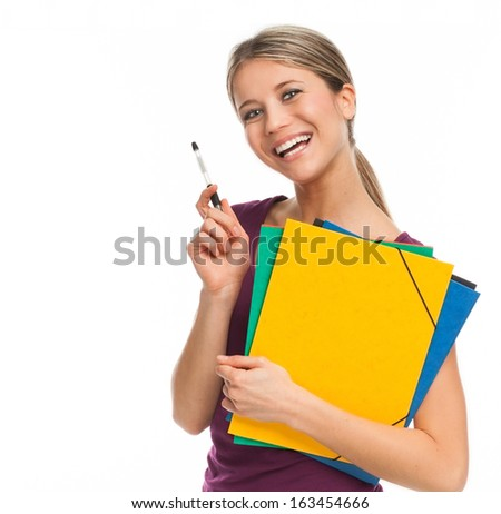 Young student smiling, holding folders and pen, isolated on white - stock photo