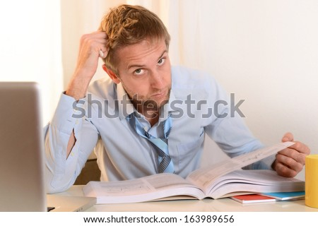 Young Student Stressed and Overwhelmed before an Exam on clear Background - stock photo