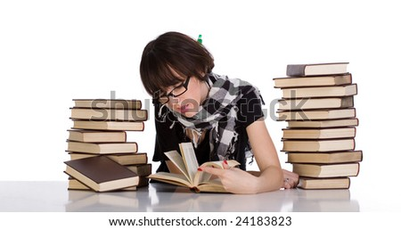 Young student studying between two pile of books - stock photo