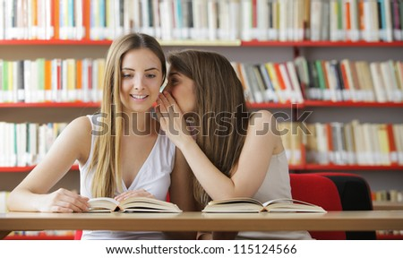 Young student tells to the girlfriend good news - stock photo