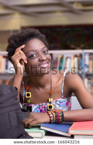 Young Student Thinking and Studying at the Library - stock photo