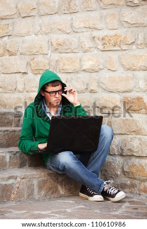 Young student using laptop - stock photo