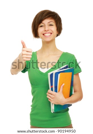 Young student with her books in hand giving thumb-up gesture, isolated on white background - stock photo