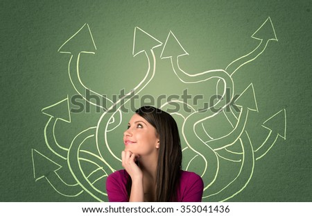 Young student with thoughtful expression with tangled arrows coming out of her back - stock photo