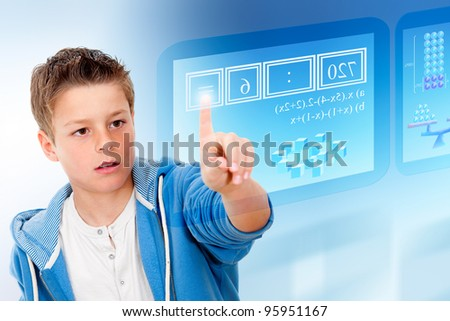 Young student with virtual futuristic interface simulating digital blackboard. - stock photo