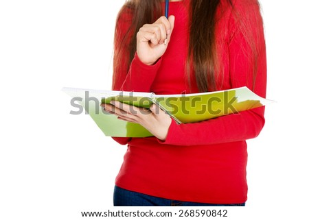 Young student woman holding note and pen.
