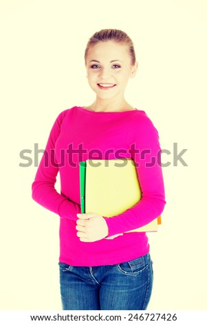 Young student woman holding workbook.  - stock photo