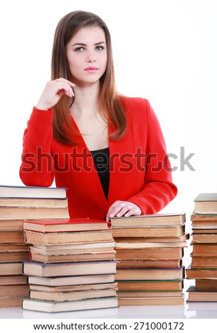 Young student woman in red suit with lots of books - stock photo