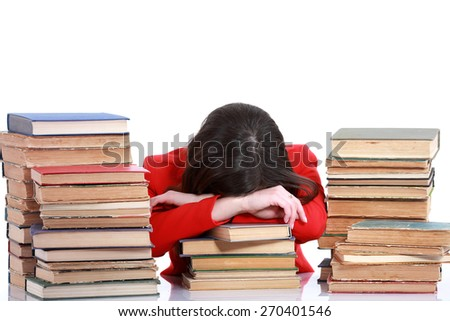Young student woman sleeping on the books - stock photo