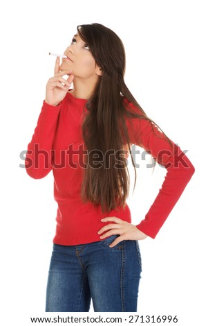 Young student woman smoking cigarette. - stock photo