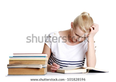 Young student woman with lots of books studying for exams. - stock photo