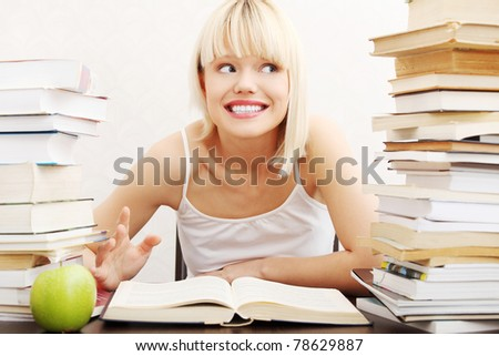 Young student woman with lots of books studying for exams. isolated on white background - stock photo
