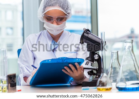 Young student working with chemical solutions in lab