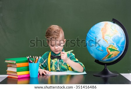 Young student writes in a notebook. - stock photo
