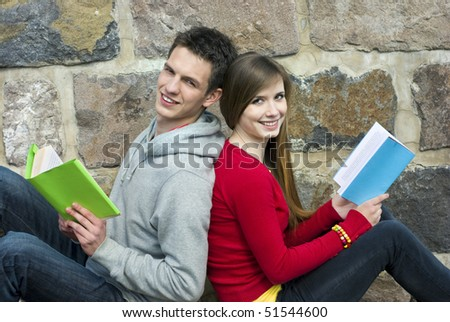 Young students are reading books together. - stock photo