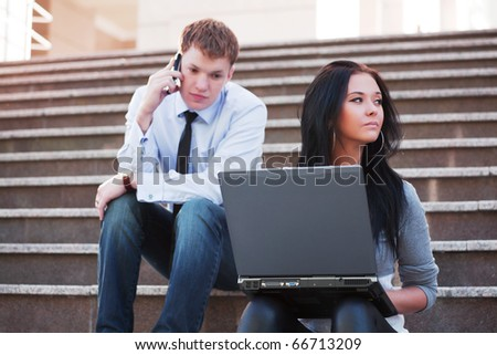 Young students on the steps. - stock photo