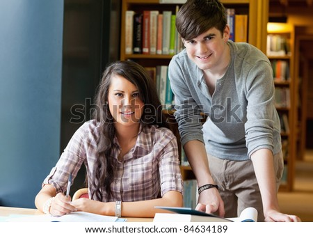 Young students posing in a library - stock photo