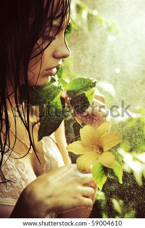 Young stunning beauty with flower - stock photo