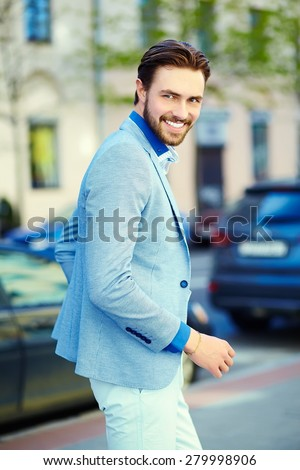 Young stylish confident happy handsome businessman model  in suit cloth lifestyle in the street  - stock photo