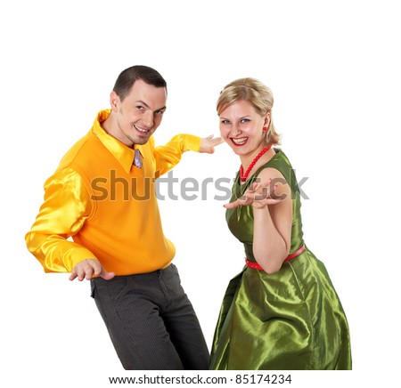 young stylish couple in bright colors wear dancing - stock photo