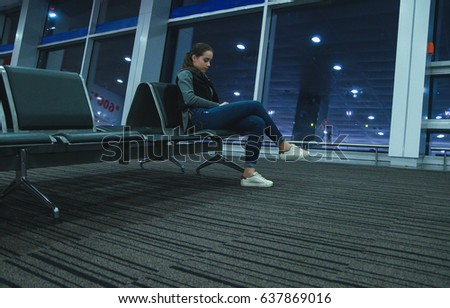 Young stylish girl in the airport