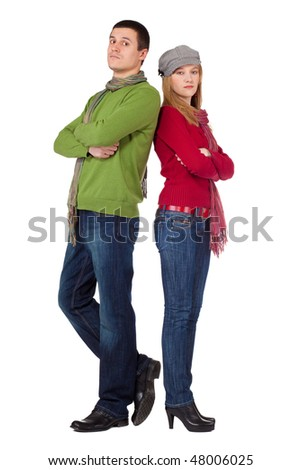 Young stylish loving couple standing